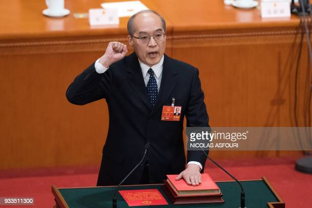 Zhang Jun takes an oath after being elected procuratorgeneral of the Supreme People's Procuratorate during the sixth plenary session of the National...