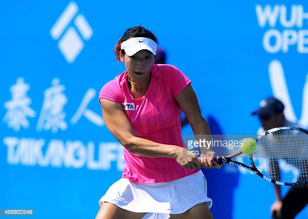 Zhang Kailin of China competes with Carla Navarro of Spain during day two of the 2014 Dongfeng Motor Wuhan Open at Optics Valley International Tennis...