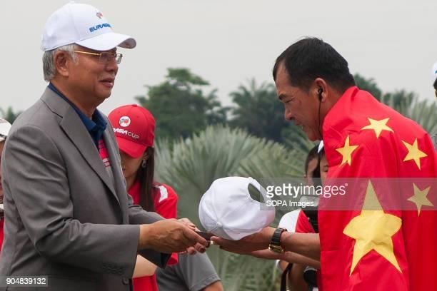 Zhang Lainwei seen receiving a ceremonial gift from the Malaysia Prime Minister Najib Razak EurAsia Cup is a biennial men professional team golf...