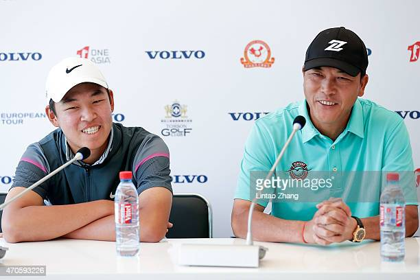 Zhang Liangwei with Jin Cheng of China speaks to the media during a news conference during the proam prior to the start of the Volvo China Open at...