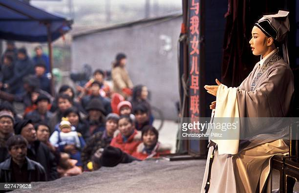 Zhang Lin 23 leading Yue opera performer from the Xiao Bai Hua Shaoxing Opera Troupe during a performance in a rural farming village close to...