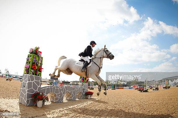Zhang Linbin of China rides Karsen competes in Modern Pentathlon Men's Individual Riding in day fourteen of the 2014 Asian Games at Dream Park...