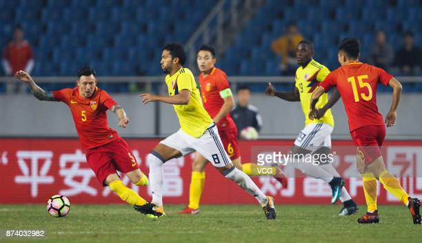 Zhang Linpeng of China National Team and Abel Aguilar of Columbia National Team compete for the ball during the international friendly match between...