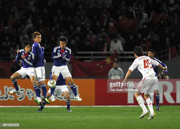 Zhang Linpeng of China takes a free kick during the East Asian Football Championship match between Japan and China at the National Stadium on...