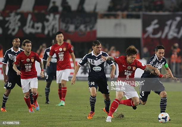 Zhang Linpeng of Guangzhou Evergrande competes with Mark Milligan of Melbourne Victory during the AFC Champions League 2014 group stage match between...