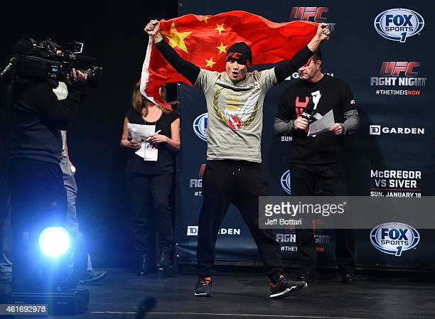 Zhang Lipeng walks on stage with a Chinese flag during the UFC Fight Night Boston weighin event at the Orpheum Theatre on January 17 2015 in Boston...
