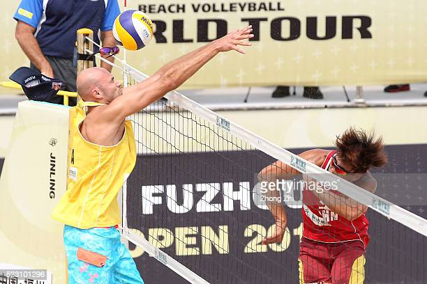 Zhang Lizeng of China in action with Chen Cheng of China during the match against Philip Dalhausser of USA and Nicholas Lucena of USA during the FIVB...