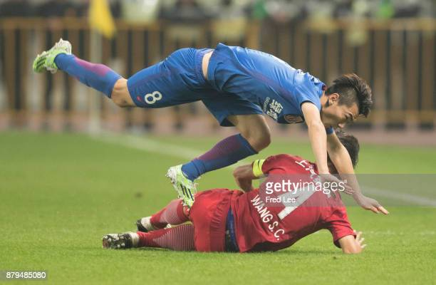 Zhang Lu of Shanghai Greenland Shenhua and Wang rongchao of Shanghai SIPG in action during the 2017 CFA Cup Final Round match between Shanghai SIPG...