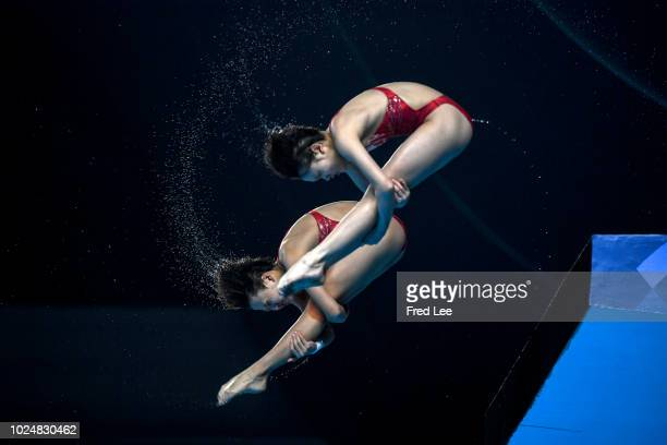 Zhang Minjie and Zhang Jiaqi of China perform in the women's synchronised 10m platform event duringduring on day ten of the Asian Games on August 28,...