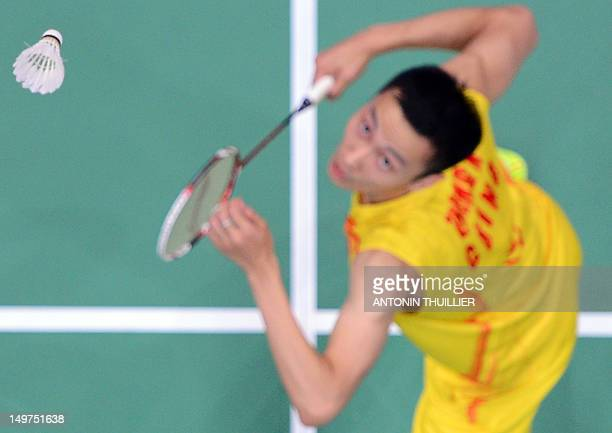 Zhang Nan of China prepares to play a smash during his mixed doubles final badminton match with Zhao Yunlei against compatriots Ma Jin and Xu Chen in...