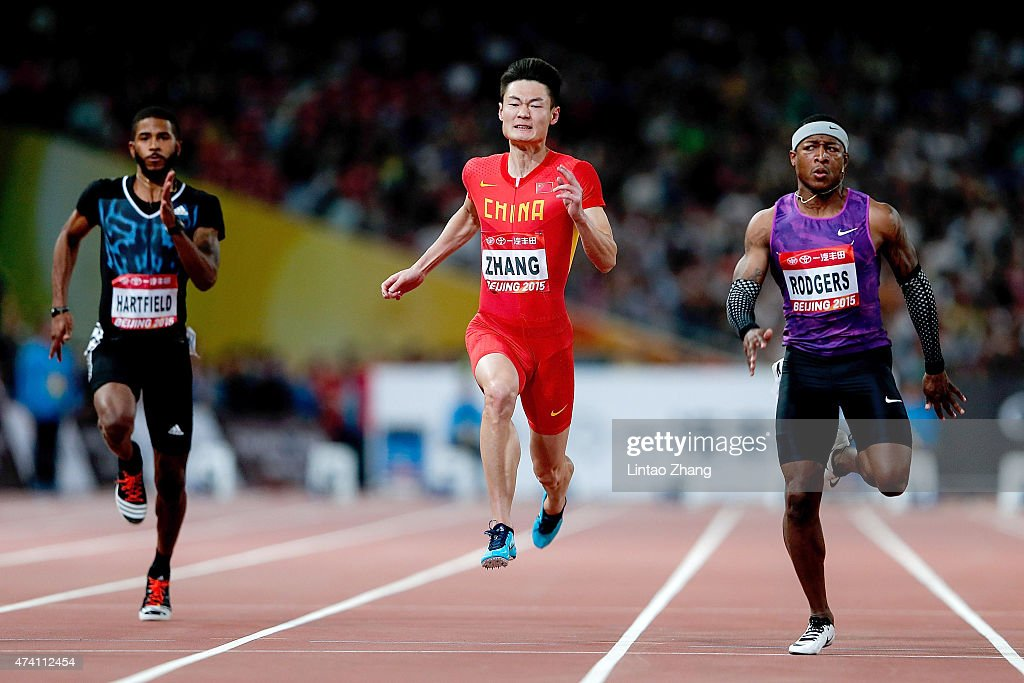 Zhang Peimeng of China (C) and Michael Rodgers (R) of the United States compete in the Men's 100m during the 2015 IAAF World Challenge Beijing at National Stadium on May 20, 2015 in Beijing, China.