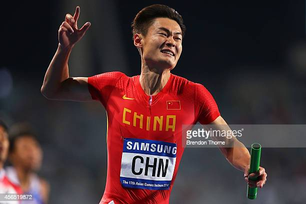 Zhang Peimeng of China celebrates claiming the Gold medal in the Men's 4x100m Relay Final during day thirteen of the 2014 Asian Games at Incheon...