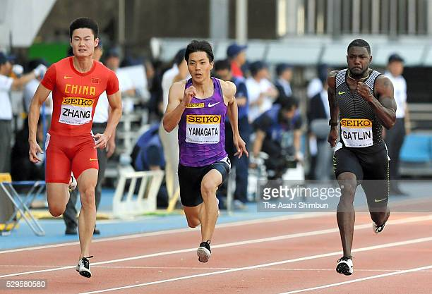 Zhang Peimeng of China Ryota Yamagata of Japan and Justin Gatlin of the United States compete in the Men's 100m during the SEIKO Golden Grand Prix...