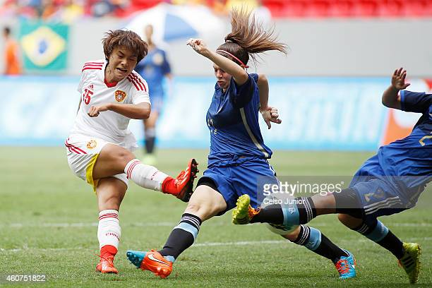 Zhang Rui of China and Camila Gomes Ares of Argentia compete in the Brasilia International Tournament match between Argentina and China at Mane...