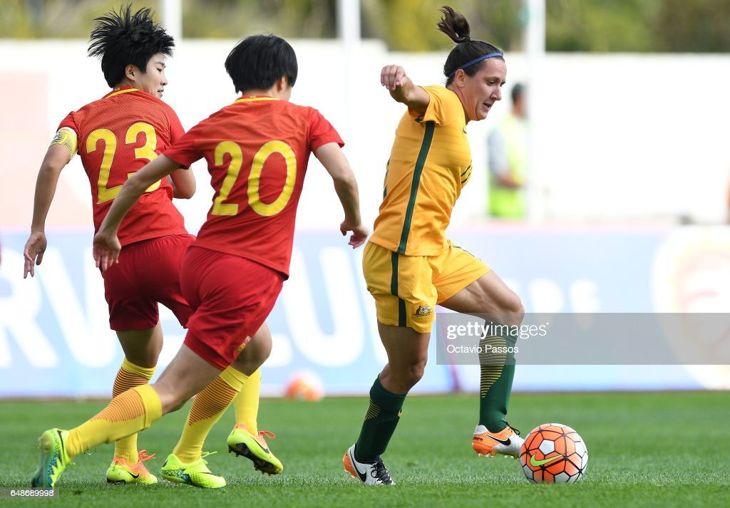 Zhang Rui of China competes for the ball with Lisa De Vanna of Australia during the Women's Algarve Cup Tournament match between China and Australia at Municipal de Albufeira on March 6, 2017 in Albufeira, Portugal.