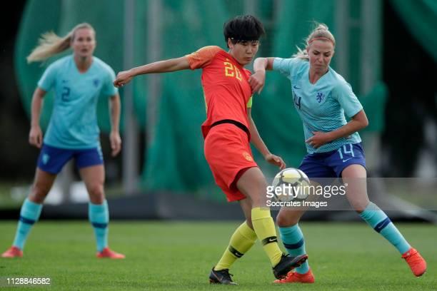 Zhang Rui of China Women, Jackie Groenen of Holland Women during the Algarve Cup Women match between China PR v Holland at the Estadio Municipal de...