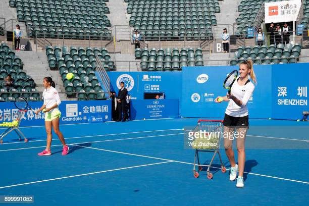 Zhang Shuai of China and Kristyna Pliskova of Czech Republic play a game during Kids Day ahead of the 2018 WTA Shenzhen Open at Longgang Sports...