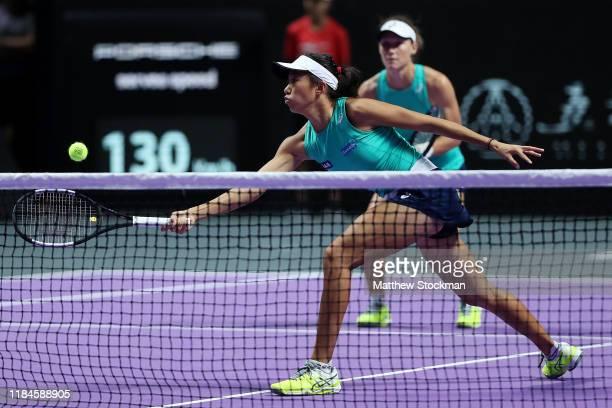 Zhang Shuai of China and Samantha Stosur of Australia return the ball against Barbora Krejcikova and Katerina Siniakova of the Czech Republic during...