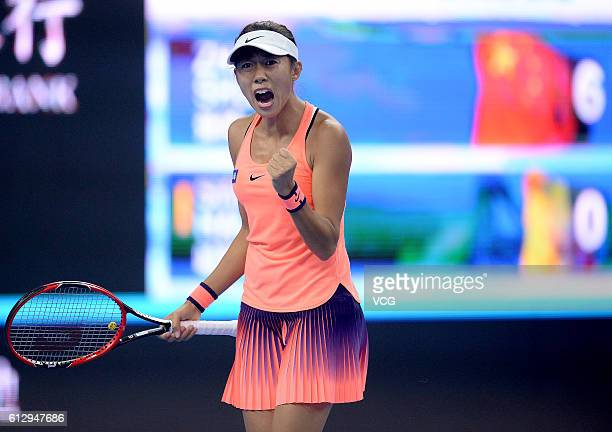 Zhang Shuai of China celebrates a point against Simona Halep of Romania during the Women's singles third round match on day six of the 2016 China...