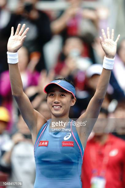 Zhang Shuai of China celebrates after defeating Angelique Kerber of Germany during her women's singles third round match in the 2018 China Open at...