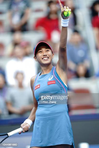 Zhang Shuai of China celebrates after defeating Timea Babos of Hungary during their Women's Singles 2nd Round match of the 2018 China Open at the...