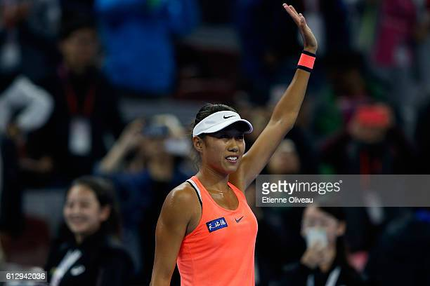 Zhang Shuai of China celebrates her victory over Simona Halep of Romania during the Women's singles third round match on day six of the 2016 China...