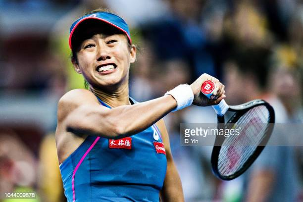 Zhang Shuai of China cries after winning the game against Elise Mertens of Belgium during her women's singles first round match of the 2018 China...