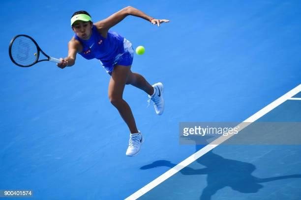 TOPSHOT Zhang Shuai of China hits a return against Zarina Diyas of Kazakhstan in their women's singles second round match at the Shenzhen Open tennis...