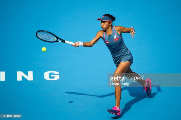 Zhang Shuai of China Hits a return during her Women's Singles Quarterfinals match against Naomi Osaka of Japan in the 2018 China Open at the China...
