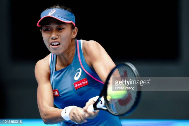 Zhang Shuai of China hits a return during her women's singles third round match against Angelique Kerber of Germany during her women's singles third...