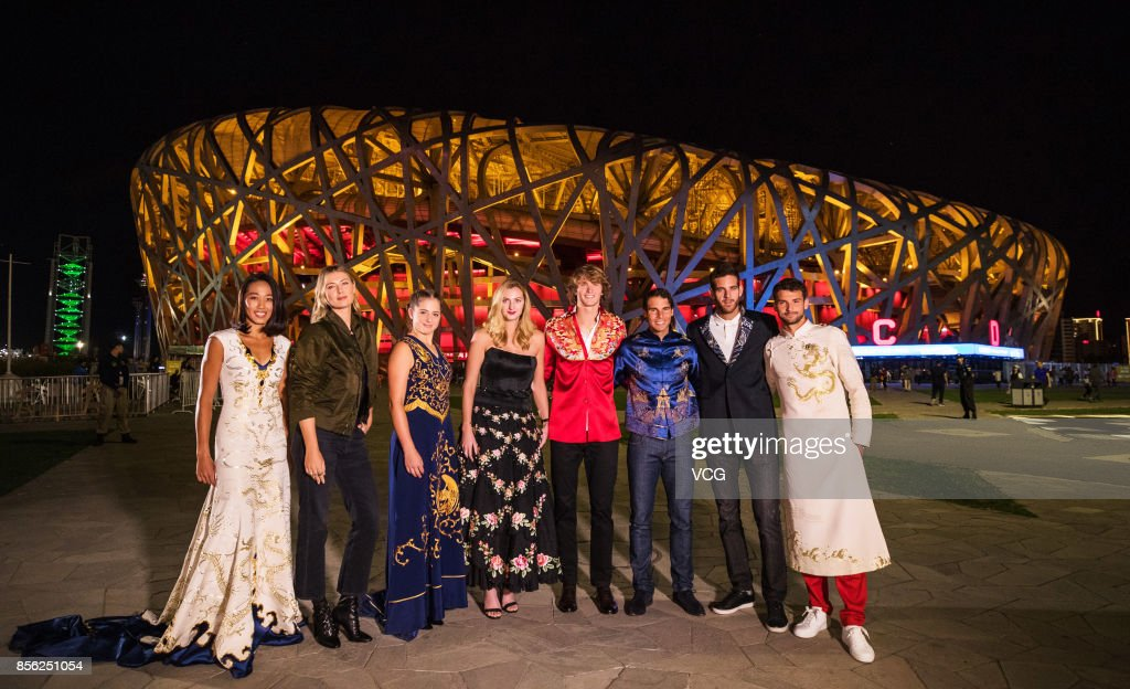 Zhang Shuai of China, Maria Sharapova of Russia, Jelena Ostapenko of Latvia, Petra Kvitova of Czech Republic, Alexander Zverev of Germany, Rafael Nadal of Spain, Juan Martin Del Porto of Argentina and Grigor Dimitrov of Bulgaria pose for a picture in front of the National Stadium before the 2017 China Open Player Party on October 1, 2017 in Beijing, China.