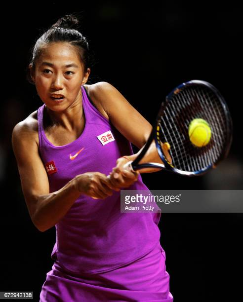 Zhang Shuai of China plays a backhand in her match against Laura Siegemund of Germany during the Porsche Tennis Grand Prix at Porsche Arena on April...