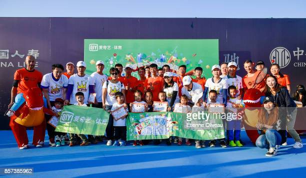 Zhang Shuai of China poses for a picture with guests and staff members during the Iqiyi kids day on day five of the 2017 China Open at the China...