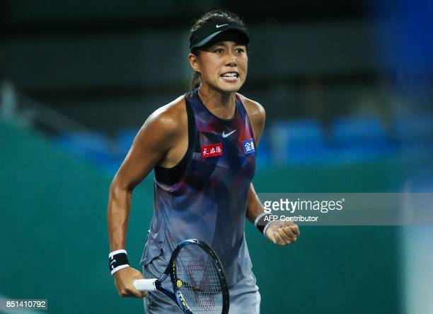 Zhang Shuai of China reacts after a point against Evgeniya Rodina of Russia during their women's singles semifinal match at the WTA Guangzhou Open...