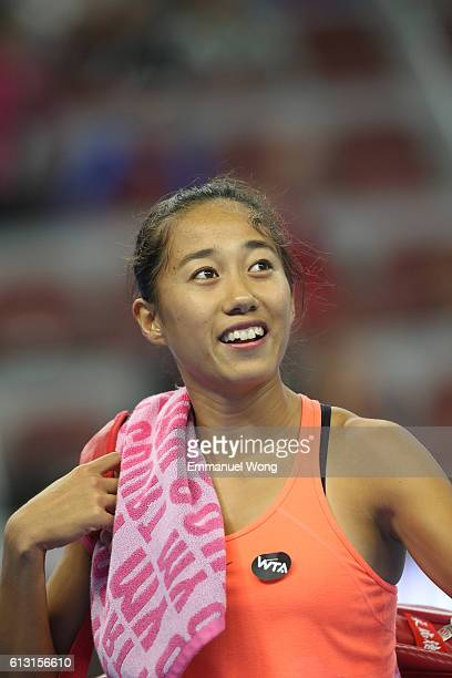 Zhang Shuai of China reacts after losing the Women's Singles Quarterfinals match against Johanna Konta of Great Britain on day seven of the 2016...