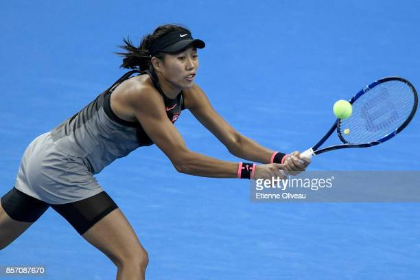 Zhang Shuai of China returns a shot against Agnieszka Radwanska of Poland during their Women's single second round match on day four of the 2017...