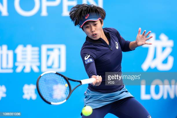 Zhang Shuai of China returns a shot against Ons Jabeur of Tunisia during the women's singles 1st round match on main draw day 2 of the 2019 WTA...