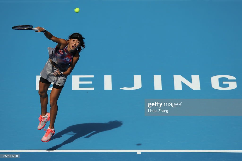 Zhang Shuai of China returns a shot against Yulia Putintseva of Kazakhstan during the Women's singles first round match on day two of the 2017 China Open at the China National Tennis Centre on October 1, 2017 in Beijing, China.
