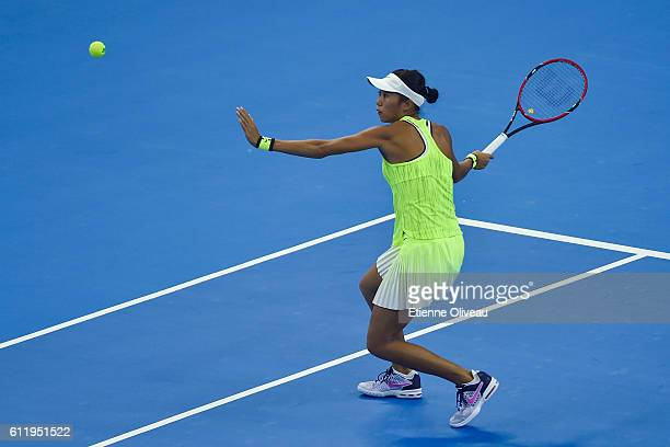 Zhang Shuai of China returns a shot to Samantha Stosur of Australia during the Women's singles first round on day two of the 2016 China Open at the...