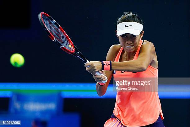 Zhang Shuai of China returns shot Simona Halep of Romania during the Women's singles third round match on day six of the 2016 China Open at the China...