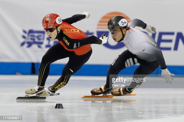 Zhang Tianyi of China and Sandor Liu Shaolin of Hungary compete in the Men 1000m final duirng the 2019 Shanghai Trophy at the Oriental Sports Center...