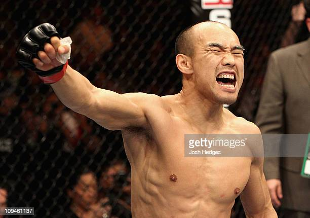 Zhang Tie Quan of China celebrates after winning by submission over Jason Reinhardt of the USA during their Featherweight bout at UFC 127 at Acer...