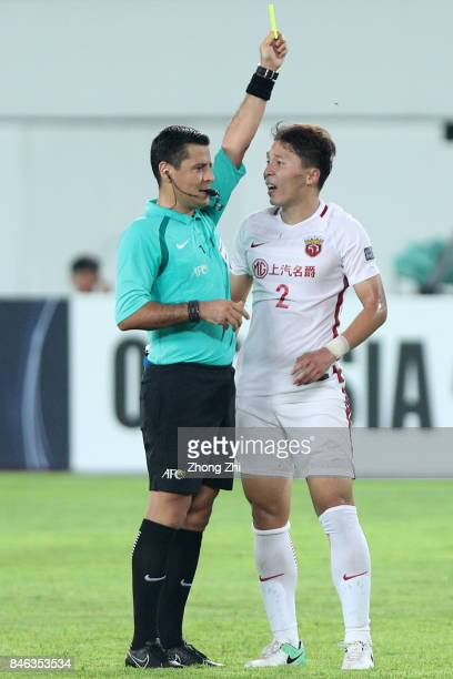 Zhang Wei of Shanghai SIPG is shown a yellow card by referee Alireza Faghani during the AFC Champions League 2017 Quarterfinals 2nd leg between...