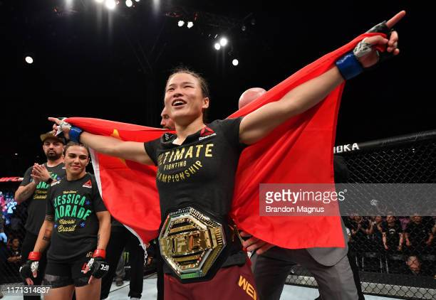 Zhang Weili of China celebrates after her knockout victory over Jessica Andrade of Brazil in their UFC strawweight championship bout during the UFC...