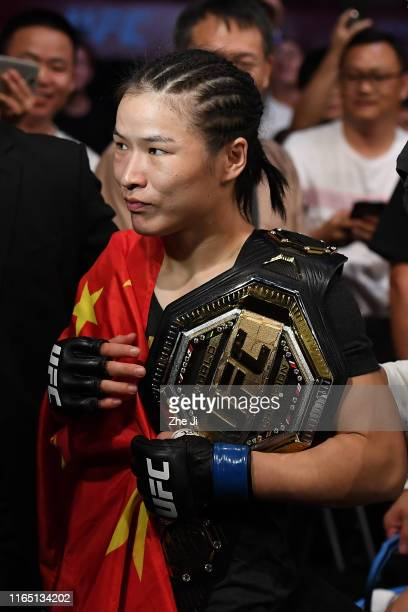 Zhang Weili of China celebrates after her victory over Jessica Andrade in their UFC strawweight championship bout during the UFC Fight Night event at...
