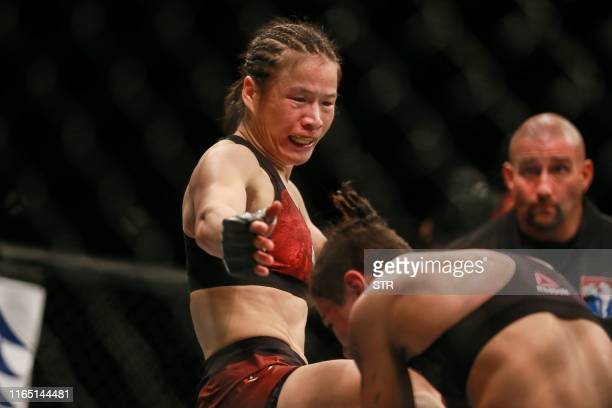 Zhang Weili of China competes against Jessica Andrade of Brazil during in their UFC mixed martial arts bout in Shenzhen Guangdong province on August...