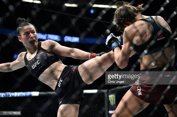 Zhang Weili of China kicks Joanna Jedrzejczyk of Poland in their UFC strawweight championship fight during the UFC 248 event at TMobile Arena on...