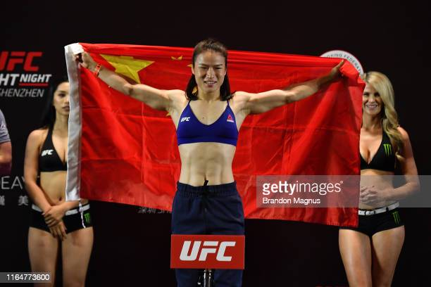 Zhang Weili of China poses on the scale during the UFC Fight Night weigh-ins at the Futian Shangri-La on August 30, 2019 in Shenzhen, China.