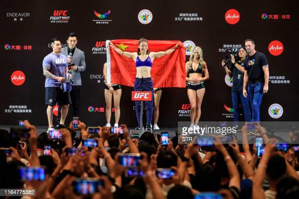 Zhang Weili of China poses with the Chinese flag during her weighin ahead of the UFC Fight Night main event fight against Jessica Andrade of Brazil...
