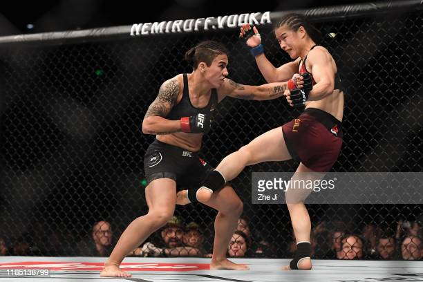 Zhang Weili of China punches Jessica Andrade of Brazil in their UFC strawweight championship bout during the UFC Fight Night event at Shenzhen...